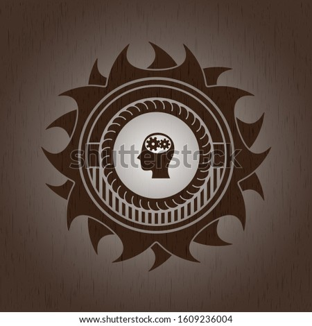 head with gears inside icon inside wood emblem. Vintage.