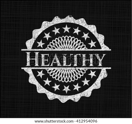 Healthy chalkboard emblem on black board