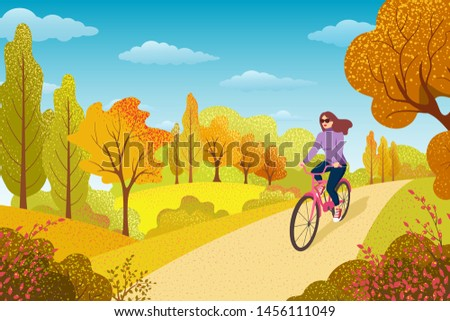 Healthy Lifestyle Concept. Active Woman Excercising in Park. Girl Riding Bicycle. Outdoor Activities. Autumn  Landscape with Trees and Leaves.