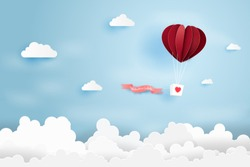 Heart air balloon made origami float over blue sky,Paper art style.