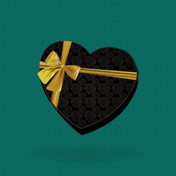 Heart-shaped Box with roses and golden bow on green background. Idea for holiday banner or poster.
