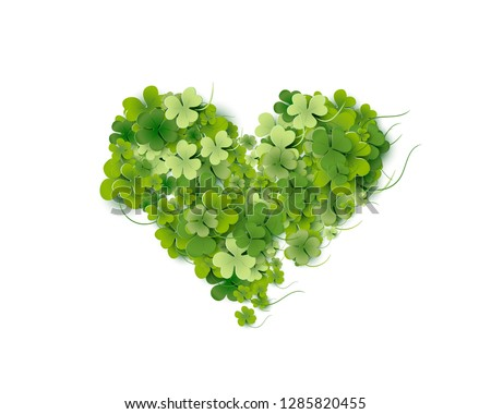 Heart shaped of bright green small shamrock leaves on white background Happy St. Patricks Day creative card. Vector illustration for wedding and greeting cards, for advertising.