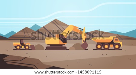 heavy excavator loading soil on dump truck professional equipment working on coal mine production mining transport concept opencast stone quarry background flat horizontal