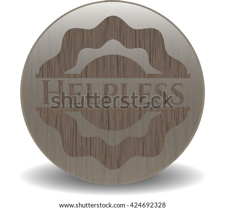 Helpless badge with wooden background