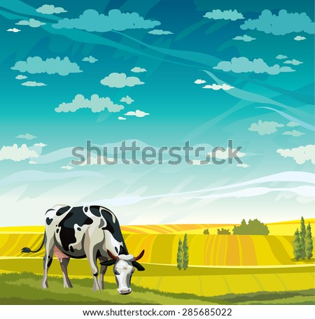 herd of cows in green field on