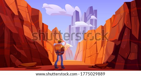 hiker man with map on desert