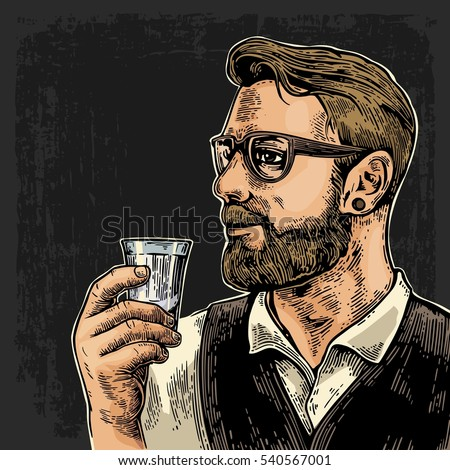 hipster holding a glass of