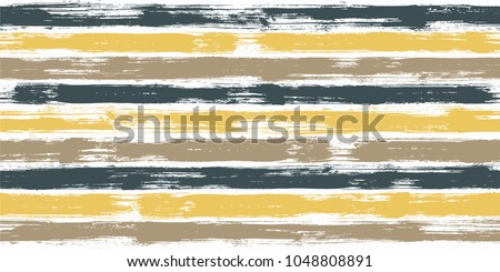 Hipster watercolor brush stripes seamless pattern. Yellow and brown paintbrush lines horizontal seamless texture for backdrop. Hand drown paint strokes design artwork. For wallpaper.