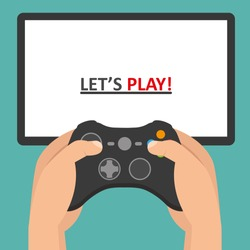 Holding in hands gamepad and playing videogame