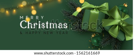 Holiday banner Merry Christmas and Happy New Year. Xmas design with realistic objects, realistic dark green color gift box, balls, light lamps garland, glitter gold confetti. Festive horizontal poster