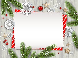 Holiday Christmas card with fir tree and festive decorations balls, stars, snowflakes on wood background. Christmas template for banner, ticket, leaflet, card, invitation, poster and so on