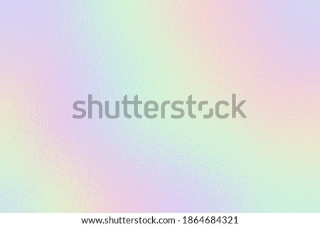 Holographic foil. Rainbow texture. Iridescent background. Neon gradient. Hologram effect. Sparkly metal texture. Soft backdrop for design prints. Silver radiance background. Metallic pattern. Vector