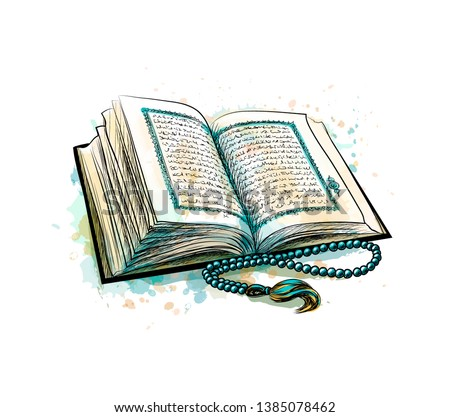 holy book of koran with rosary