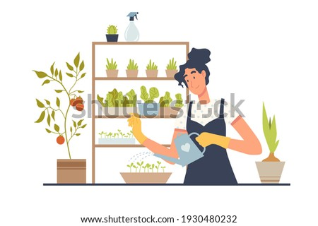Home garden. Garden on the balcony. Growing plants: vegetables and herbs at home. Woman is watering plants, caring for greens. Hobby, low-waste lifestyle and eco-friendly thinking. Stock photo ©