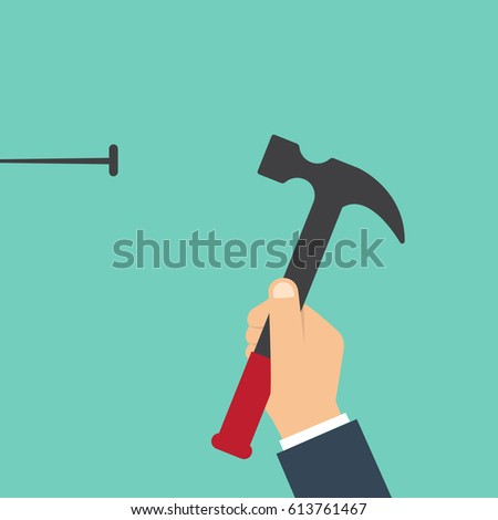 Home repairs concept. Man hammers a nail into a wall. Template construction work. Holding a hammer in hand.