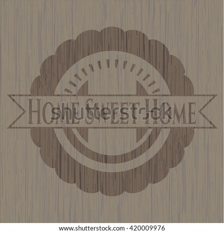 Home Sweet Home badge with wooden background