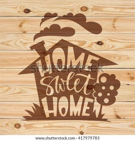 Home sweet home lettering on wood background. Modern brush pen hand lettering design.