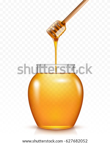 Honey flowing into glass jar .