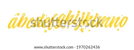 Honey font isolated on white background. Yellow typeface set with letters a, b, c, d, e, f, g, h, i, j, k, l, m, n, o. English liquid and glossy alphabet.  Stock foto ©