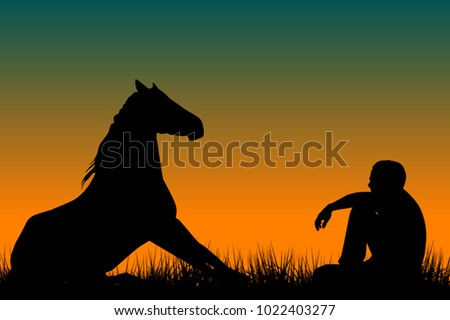 Horse and man silhouettes sitting on grass at sunset