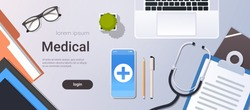 hospital worker table online mobile app top angle view doctor workplace desktop with laptop smartphone stethoscope and clipboard office stuff copy space horizontal
