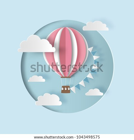 Hot air balloon with bunting flags and clouds. Paper cut style. Vector illustration