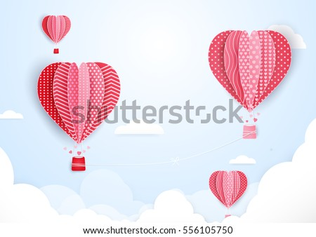 Hot air balloons in shape of heart flying in clouds. paper art and cut, origami style