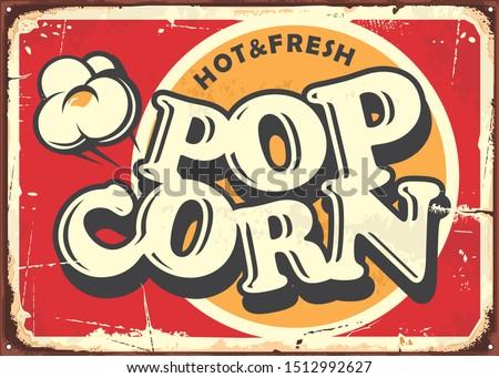 Hot and fresh popcorn vintage metal plate design template. Retro popcorn sign. Food and snacks vector illustration.