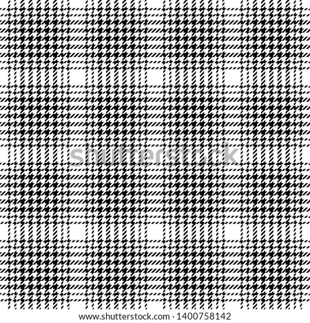 Hounds tooth check plaid pattern seamless vector. Tartan glen plaid in black and white for fashion textile design.