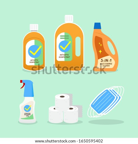 Household Supplies and Cleaning Products to Protect Family from Virus, Germs, or Bacteria. Antibacterial Disinfectant Liquid in Bottles and Spray Bottle. Tissue Roll and Surgical Mask in Bulk