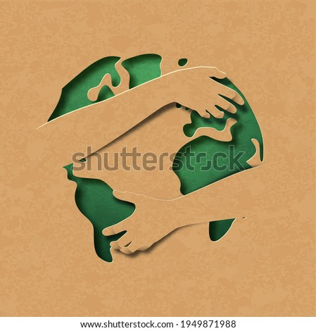 Human arms hugging 3d paper cut green earth planet on isolated recycled paper background. Environment care concept, nature love idea.