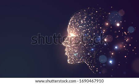 Human face on a dark background of gold glowing particles