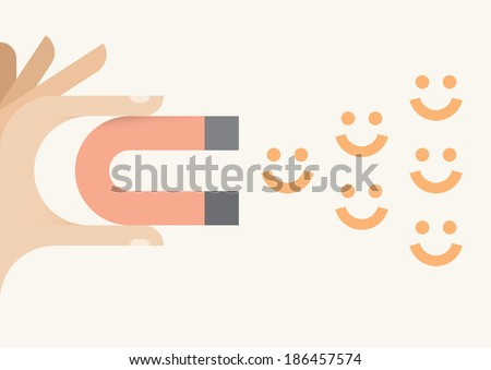 Human hand holding abstract magnet attracting smiles. Happiness and avoiding negativity concept.
