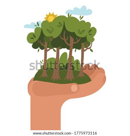 human hand holding green tree