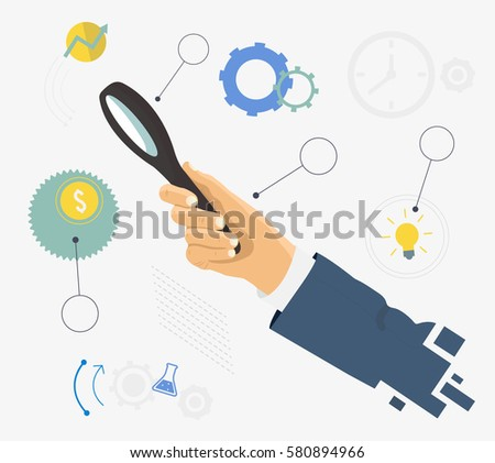human hand holding magnifying