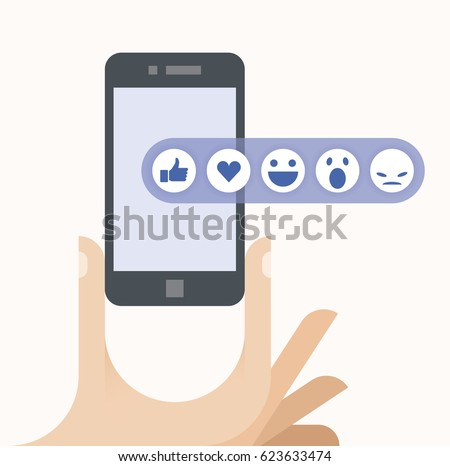 Human hand holding mobile phone with social network feedback emoticons : thumbs up, love (like), smile, angry, wonder on screen. Idea - Online communication, blogging, article feedback concepts.