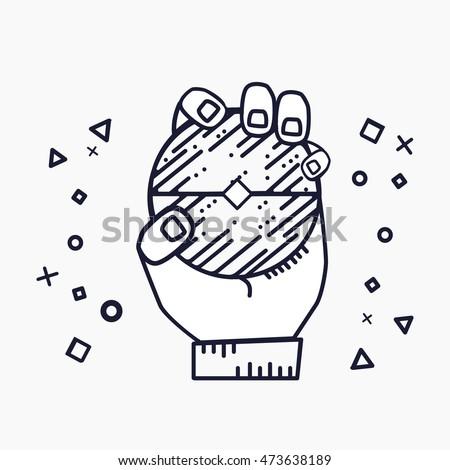human hand holds the poke ball