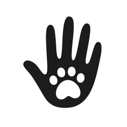 Human hand palm with dog or cat paw print symbol. Veterinary pet care, shelter adoption or animal charity logo design element. Helping hand vector illustration.