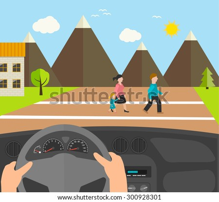 human hands driving a car
