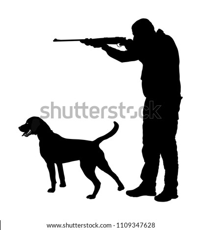 hunter with dog aiming with his