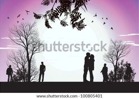 husband and wife kiss in the park