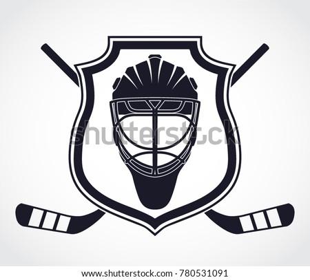 ice hockey theme with shield crossed hockey stickes and helmet heraldry symbol