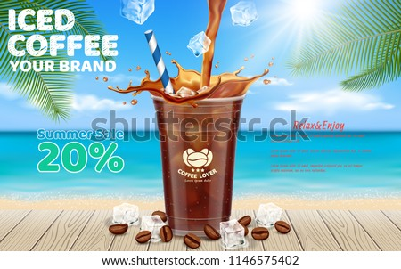 Iced coffee pouring into takeaway cup placed on wooden table with ice cubes, coffee beans ,coconut leaf set for summer beach background.