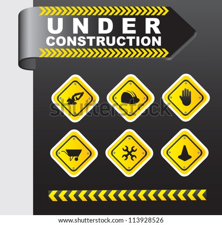Icons of under construction over chrome background