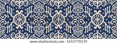 Ikat geometric folklore ornament. Oriental vector damask pattern. Ancient art of Arabesque. Tribal ethnic texture. Spanish motif on the carpet. Aztec style. Indian rug. Gypsy, Mexican embroidery. Photo stock ©