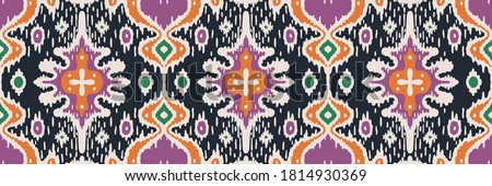 Ikat geometric folklore ornament. Oriental vector damask pattern. Ancient art of Arabesque. Tribal ethnic texture with heart. Spanish  carpet. Aztec style. Indian rug. Gypsy, Mexican embroidery.