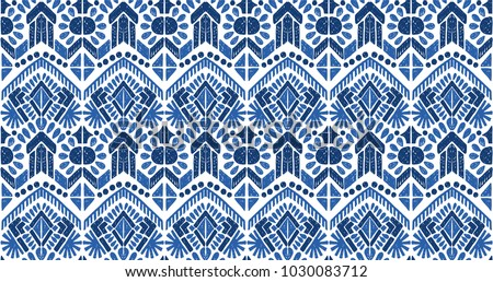 Ikat seamless pattern. Vector tie dye  shibori print with stripes and chevron. Ink textured japanese background.  Ethnic fabric vector. Bohemian fashion. Endless watercolor texture. African rug. - Shutterstock ID 1030083712