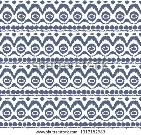 Ikat seamless pattern. Vector tie dye shibori print with stripes and chevron. Ink textured japanese background. Ethnic fabric vector. Bohemian fashion. Endless watercolor texture. African rug. #1317182963