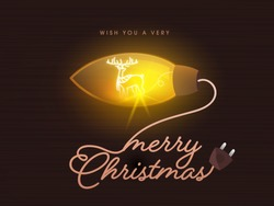 Illuminated Chandelier or String Bulb with Merry Christmas Text Written By Wire Plug on Brown Background for Celebration Concept.