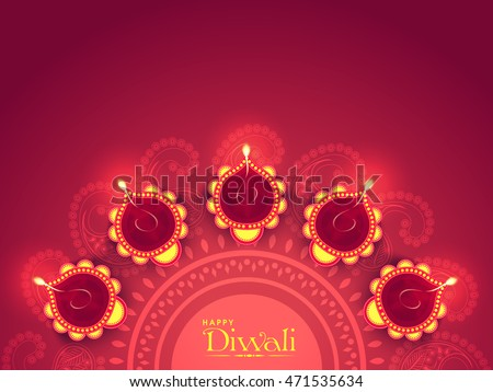 Beautiful diwali greeting download free vector art stock graphics illuminated lit lamps on beautiful floral rangoli elegant greeting card creative diwali festive background m4hsunfo